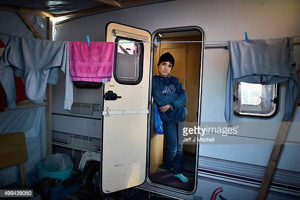 A boy looks out a camper van as migrants contend with wintery conditions in the camp known as the 'New Jungle' on December 1 2015 in Calais France...