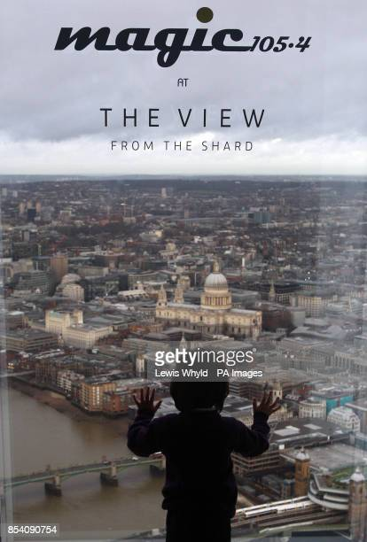 A boy looks out at the view as Neil Fox and Verity Geere broadcast Europes highest breakfast show as Magic 1054 go live from the 69th floor of the...