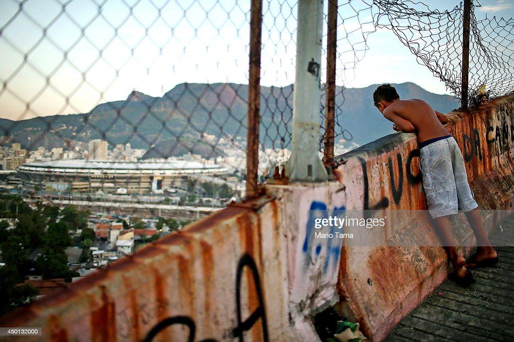 Rio Favela Overlooks Maracana World Cup Stadium : News Photo