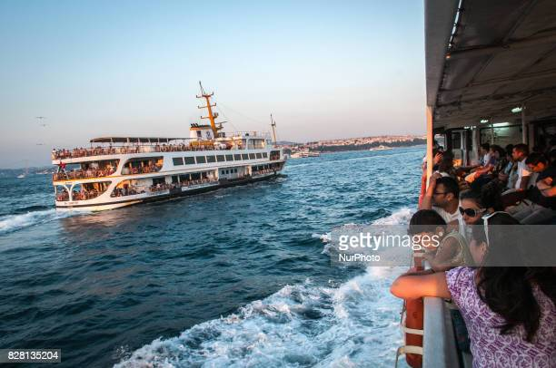 A boy looks out from a ferry boat while crossing the bosphorus in Istanbul Turkey on 28 July 2013