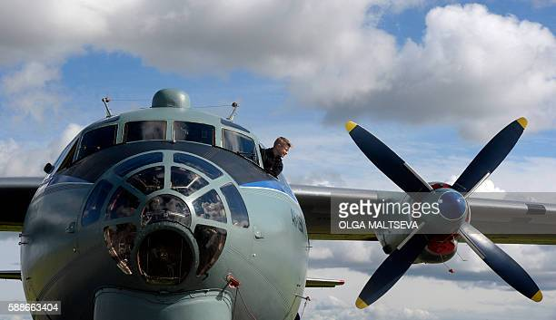 Boy looks out from the cabin of AN-12 Russian military cargo airplane during celebrations for Russian Air Force Day in Pushkin, outside of Saint...