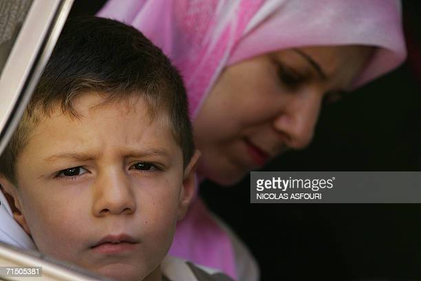 A boy looks out of a bus window as he departs along with his family on a convoy secured by the French Commando Hubert from the southern town of...