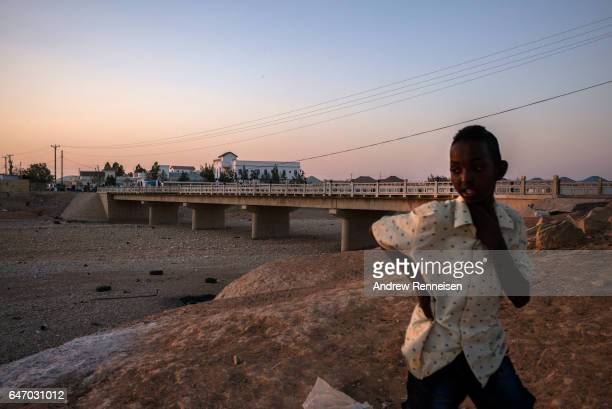 A boy looks out over a dried riverbed on February 27 2017 in Garowe Somalia Somalia is currently on the brink of famine with over half of the...