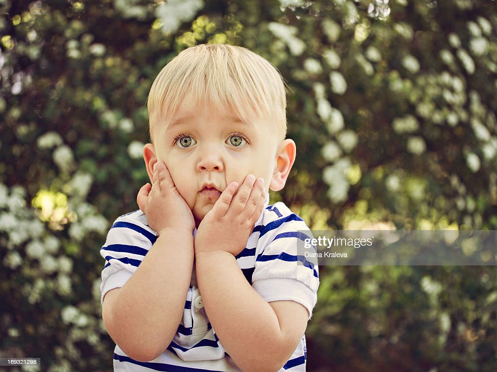 Boy looks puzzled : Stock Photo