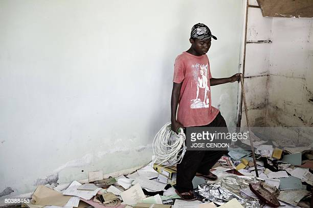 A boy looks through an abandoned police station in Mutsamudu the capital of Anjouan on 26 March 2008 Comoran and African forces on Wednesday battled...