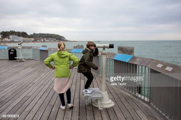 A boy looks through binoculars on Hastings Pier on April 27 2018 in Hastings England A group of local residents are attempting to raise £1 million in...