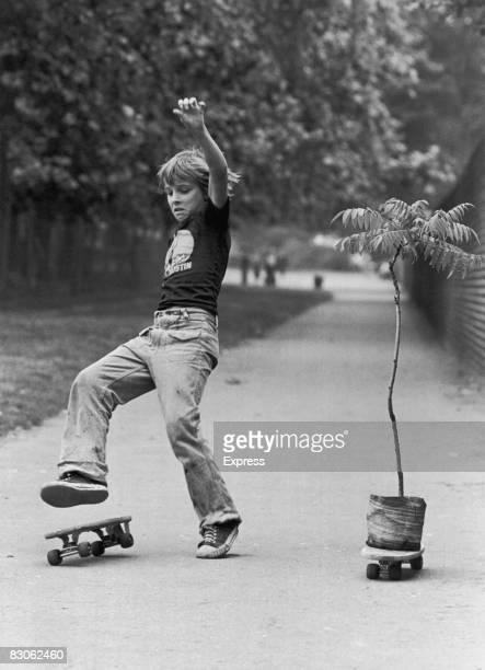 A boy loses his balance in a skateboard race against a potplant 17th August 1977