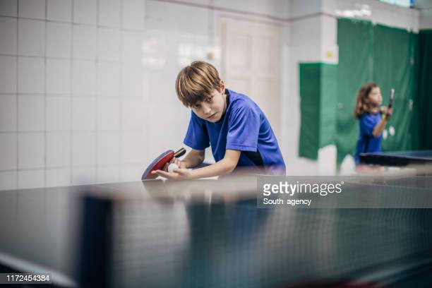 boy loves table tennis - match sport stock pictures, royalty-free photos & images