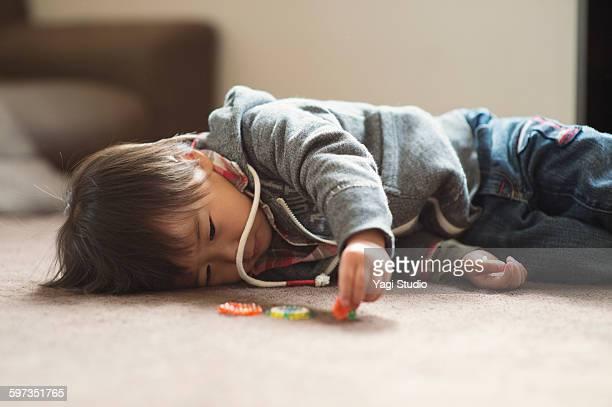 Boy lying down in room
