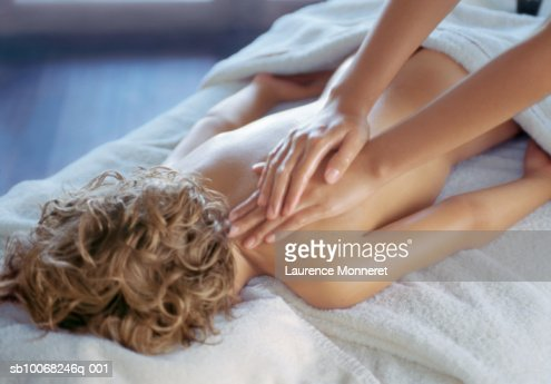 Boy Lying On Stomach Having Back Massage Stock Photo | Getty Images