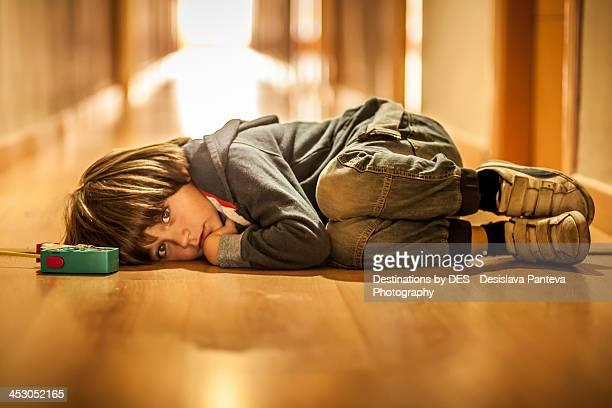 Boy lying on the groung afraid