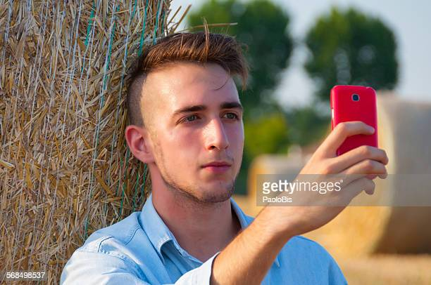 A boy make a selfie in countryside