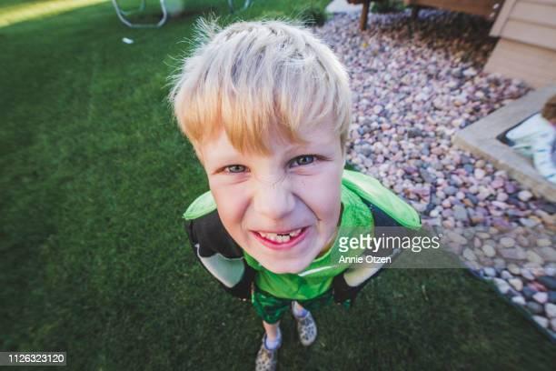 Boy makes a silly face at camera