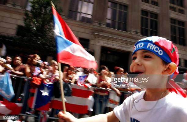 A boy makes some noise while waving a Puerto Rican flag during the ninth annual Puerto Rican Day Parade June 13 2004 in New York City Tens of...