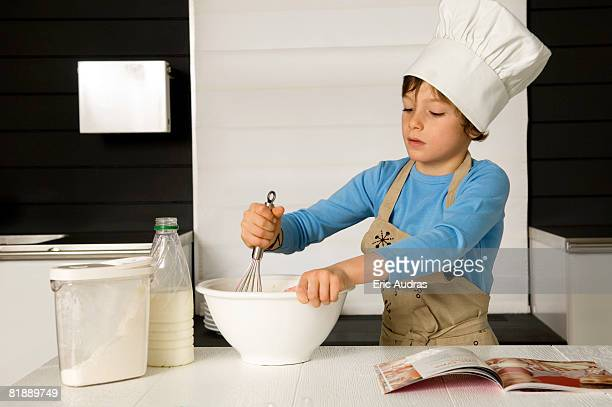 Boy making a cake