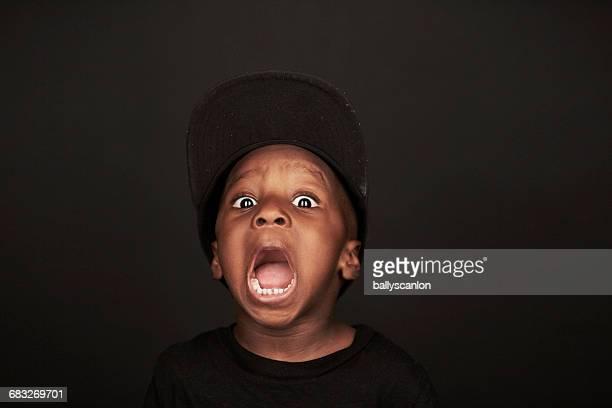 Boy Making A Face, Studio Portrait.
