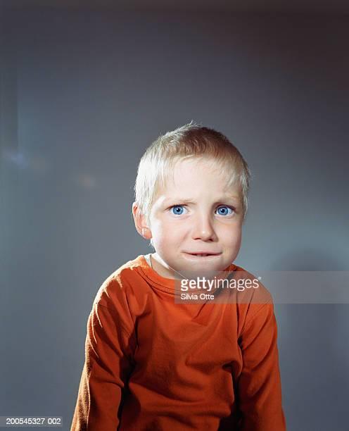 Boy (4-5) making faces, portrait, close-up