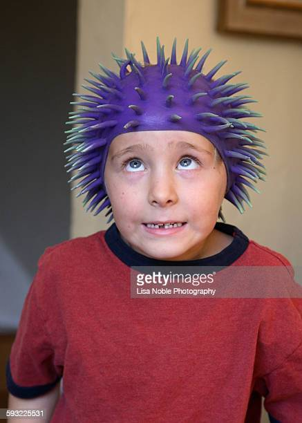 Boy making funny face wearing spiked hat