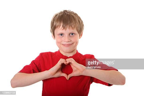 boy making heart shape wiht his hands