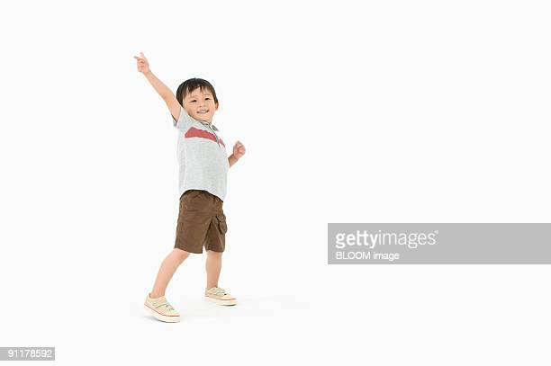 boy making pose, studio shot - asian boy stock pictures, royalty-free photos & images