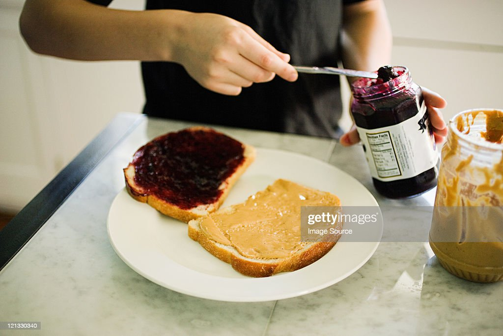 Boy making sandwich : Stock Photo
