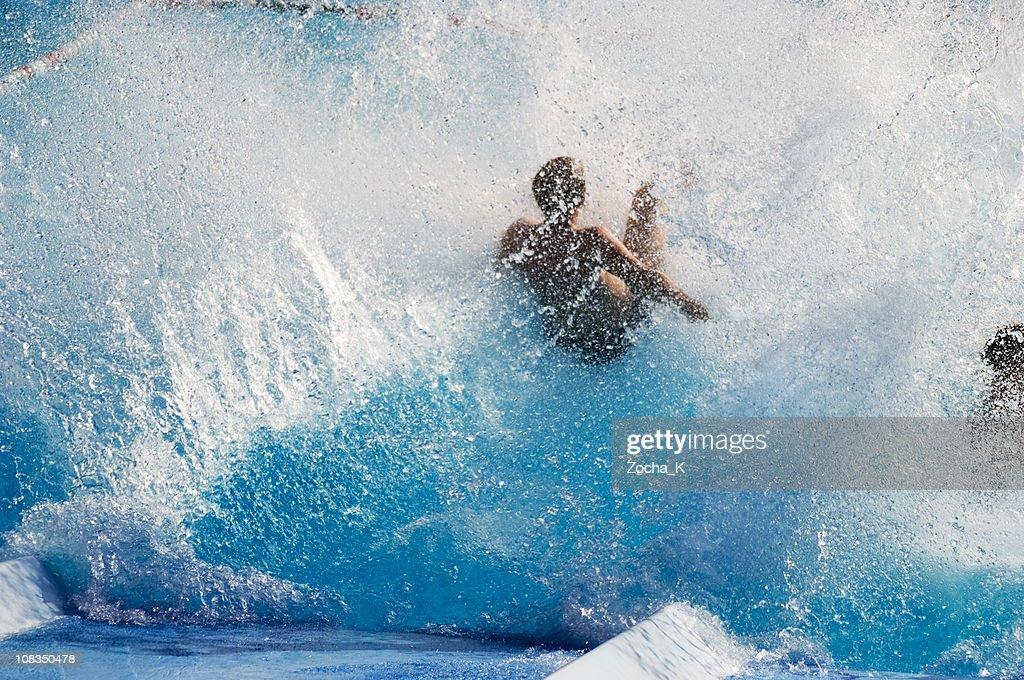 Boy making splash in pool : Stock Photo