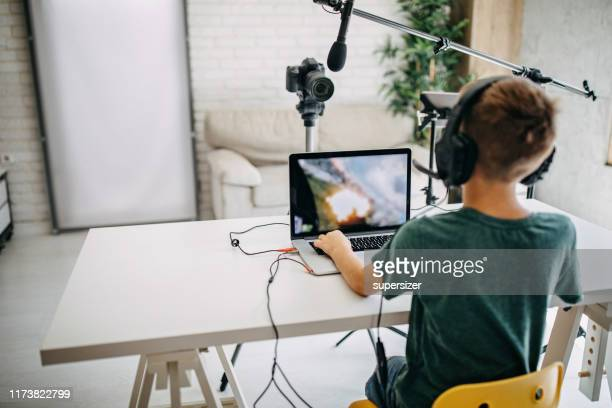 boy making vlog - esport stock pictures, royalty-free photos & images