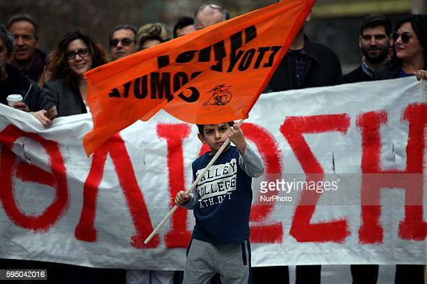 Boy marching during a big demonstration against pension reform plan in Athens on Feb 4 2016