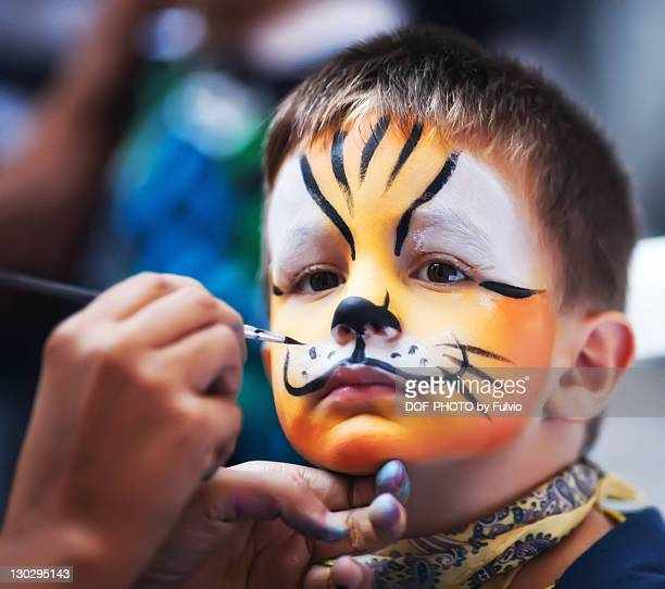 boy masked as tiger - face paint stock pictures, royalty-free photos & images