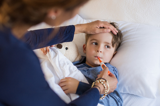 Boy measuring fever 528290460