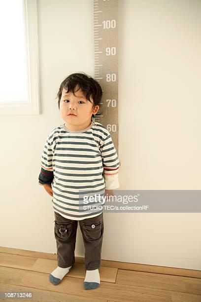 Boy measuring height