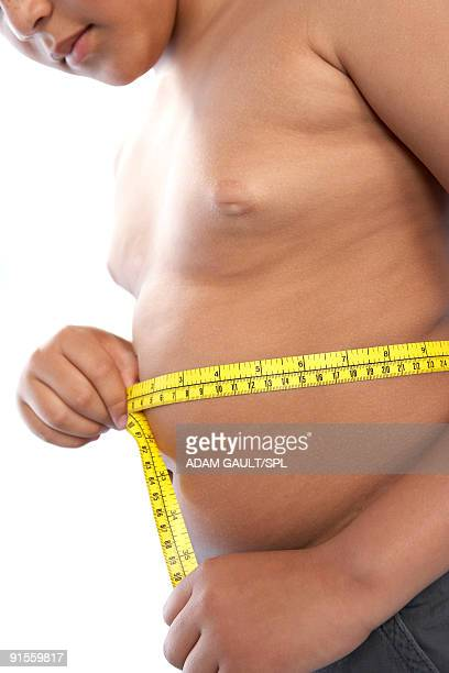 Boy measuring stomach