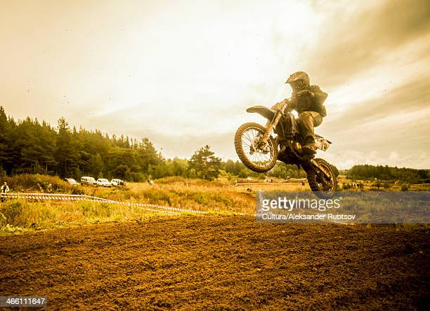 Boy mid air on motorcycle at motocross