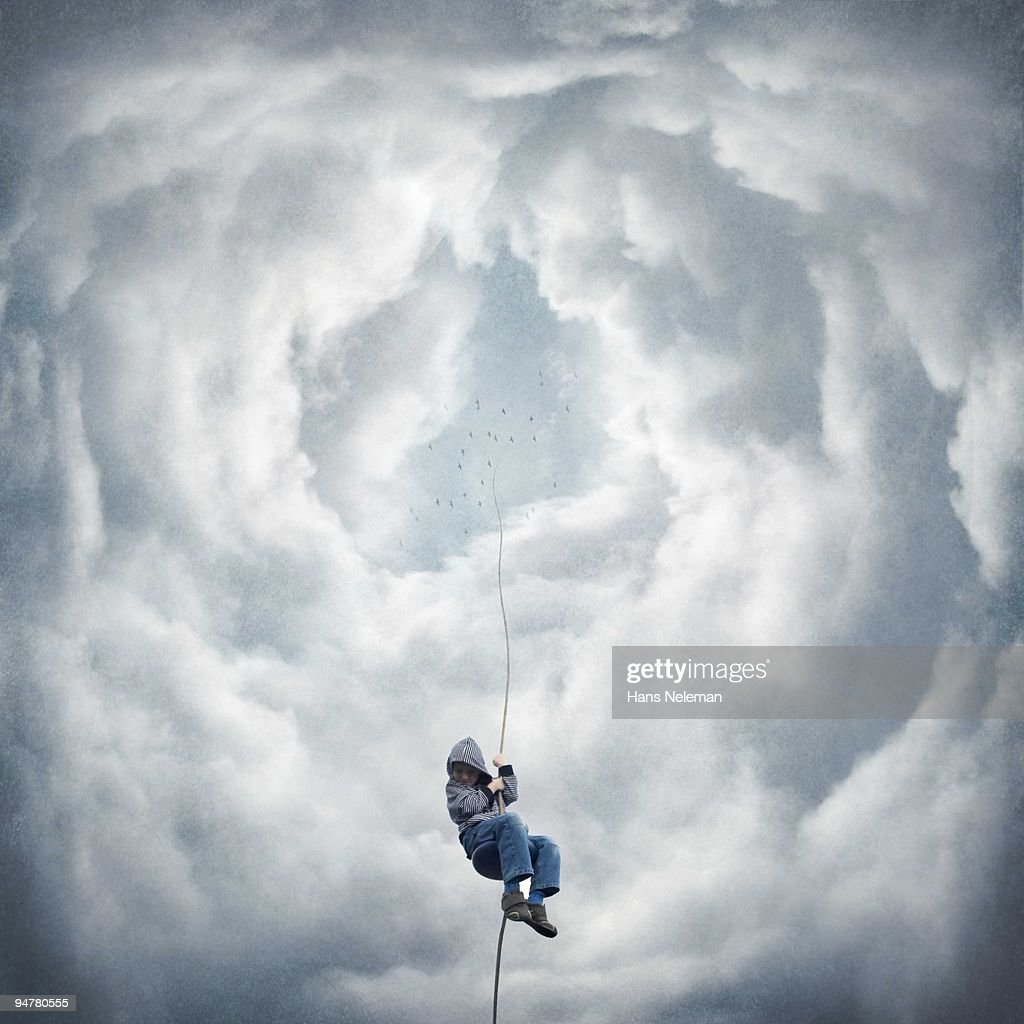 Boy moving down from the sky on a rope, Republic of Ireland : Stock Photo