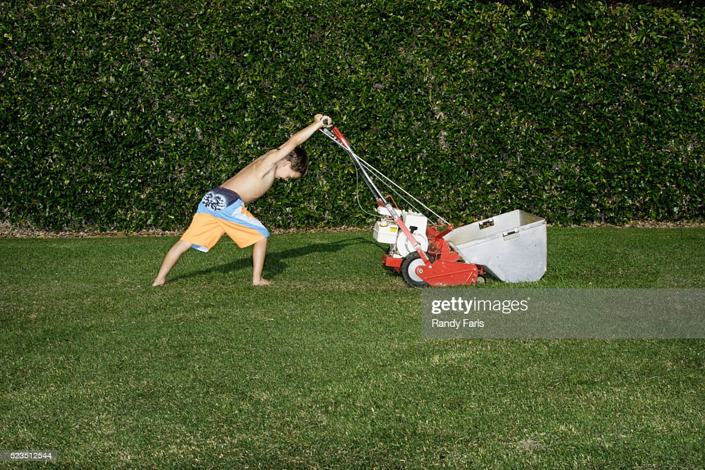 Boy Mowing the Lawn : Stock Photo