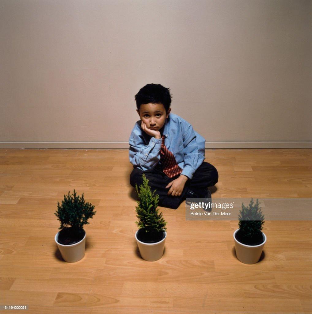 Boy near Row of Plants : Stock Photo