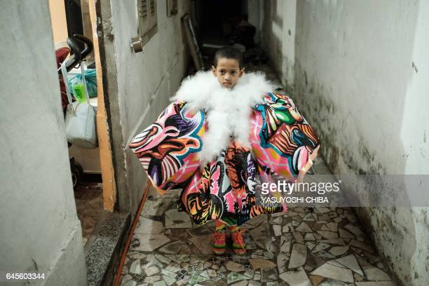A boy of the Amizade batebola street carnival band prepares for their first day of carnival in Rio de Janeiro Brazil on February 23 2017 The batebola...