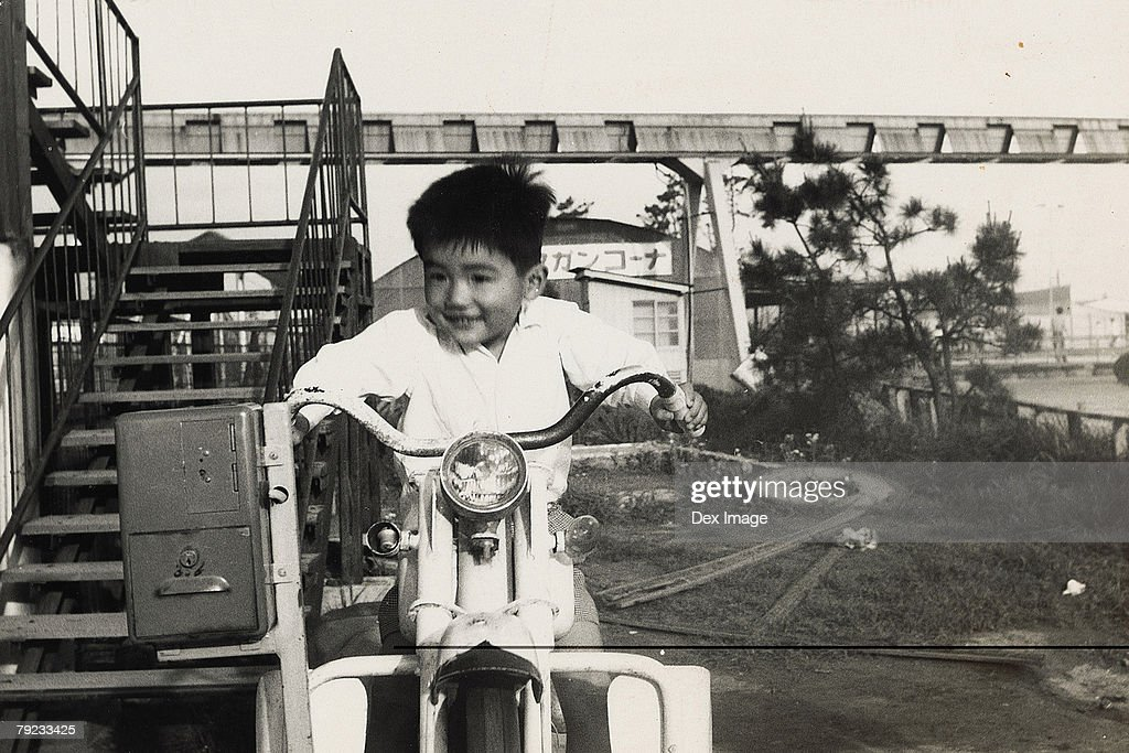 Boy on a amusement scooter ride : Stock Photo