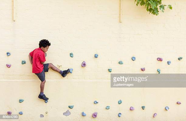 Boy on a climbing wall