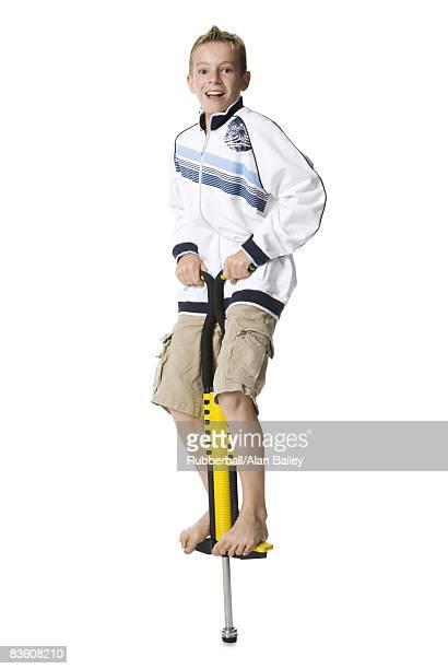 boy on a pogo stick