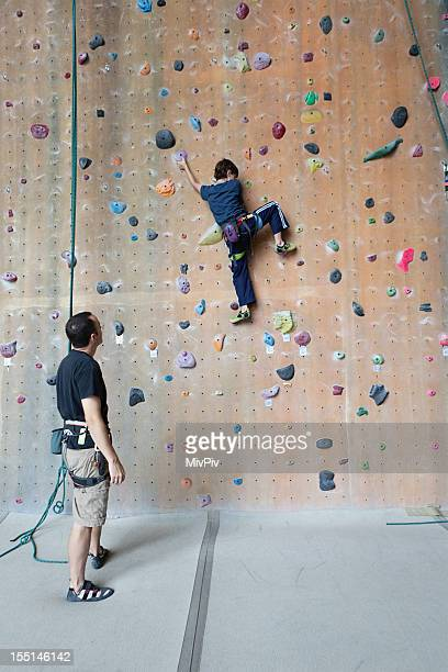 Boy on a rock climbing wall