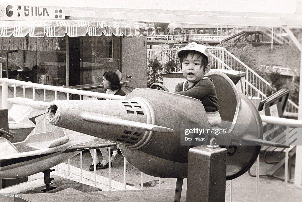 Boy on a spaceship ride : Stock Photo