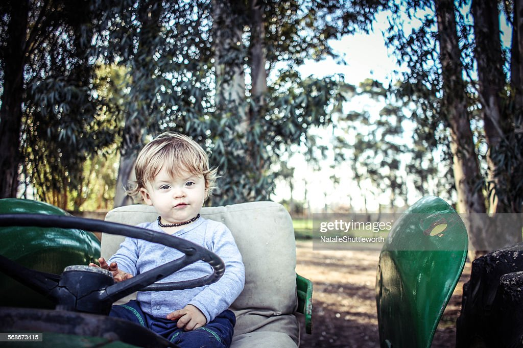 Boy on a tractor : Stock Photo