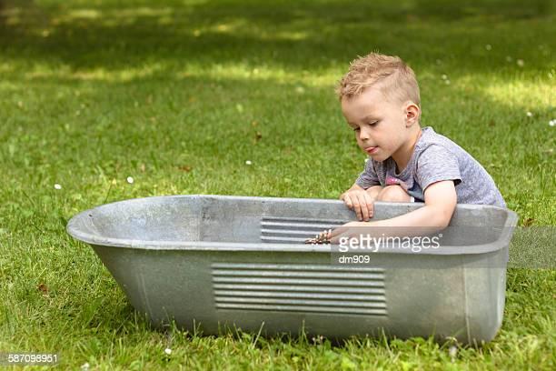 Boy on a vintage bath tub
