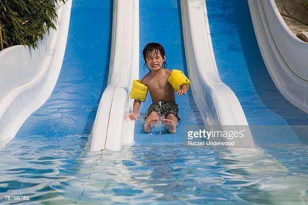 A boy on a water slide