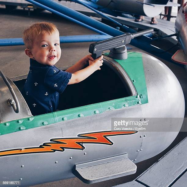 Boy On Airplane At Amusement Park