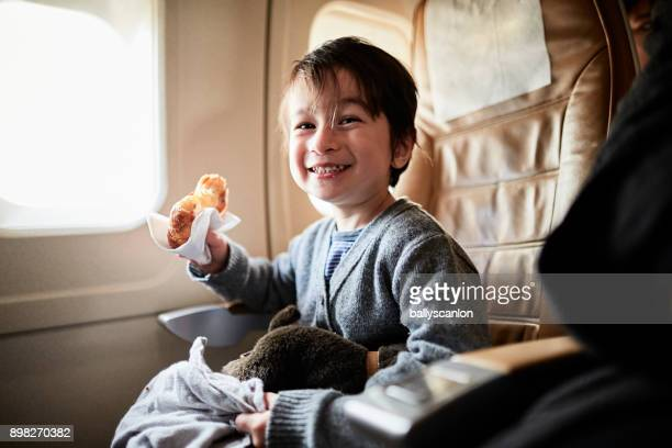 boy on airplane seat - only boys stock photos and pictures