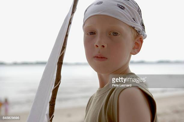 Boy on Beach Holding White Flag