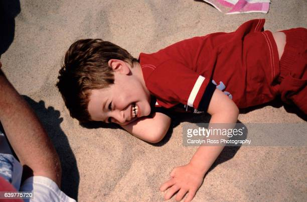 boy on beach - carolyn ross stock pictures, royalty-free photos & images