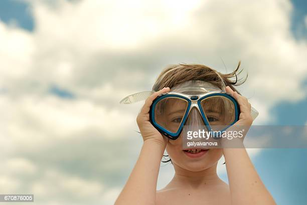 Boy on beach wearing snorkeling mask